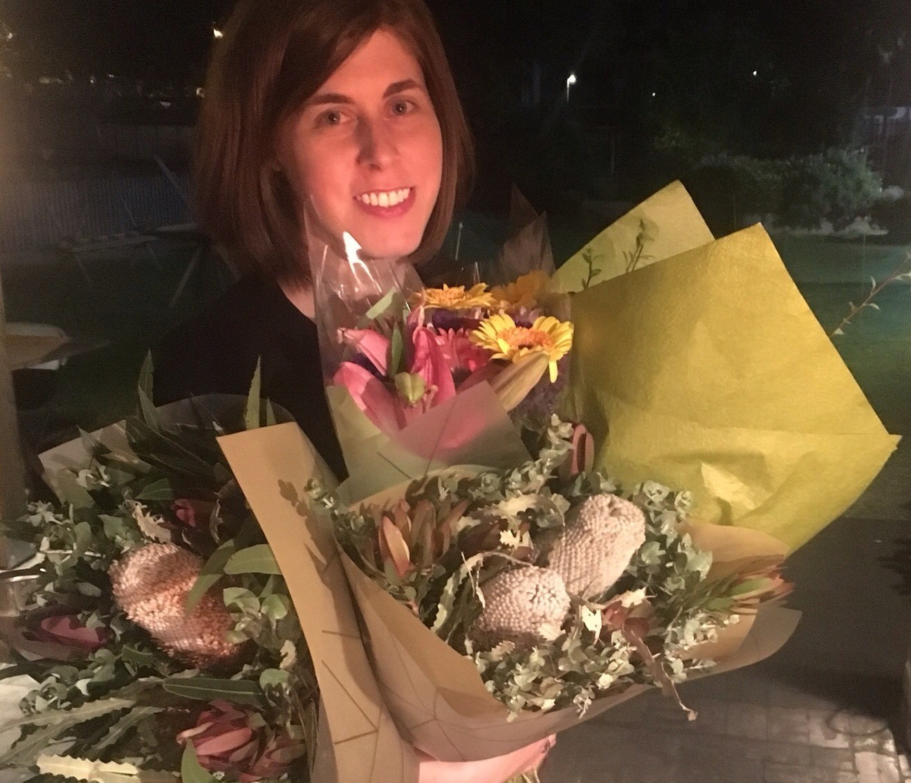 Author Ashley Kalagian Blunt at book launch with flowers