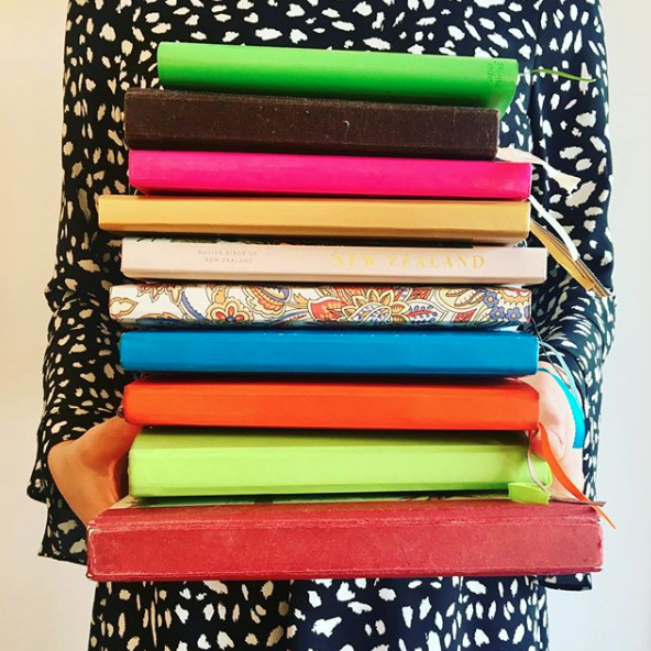 A stack of journals, a writing project