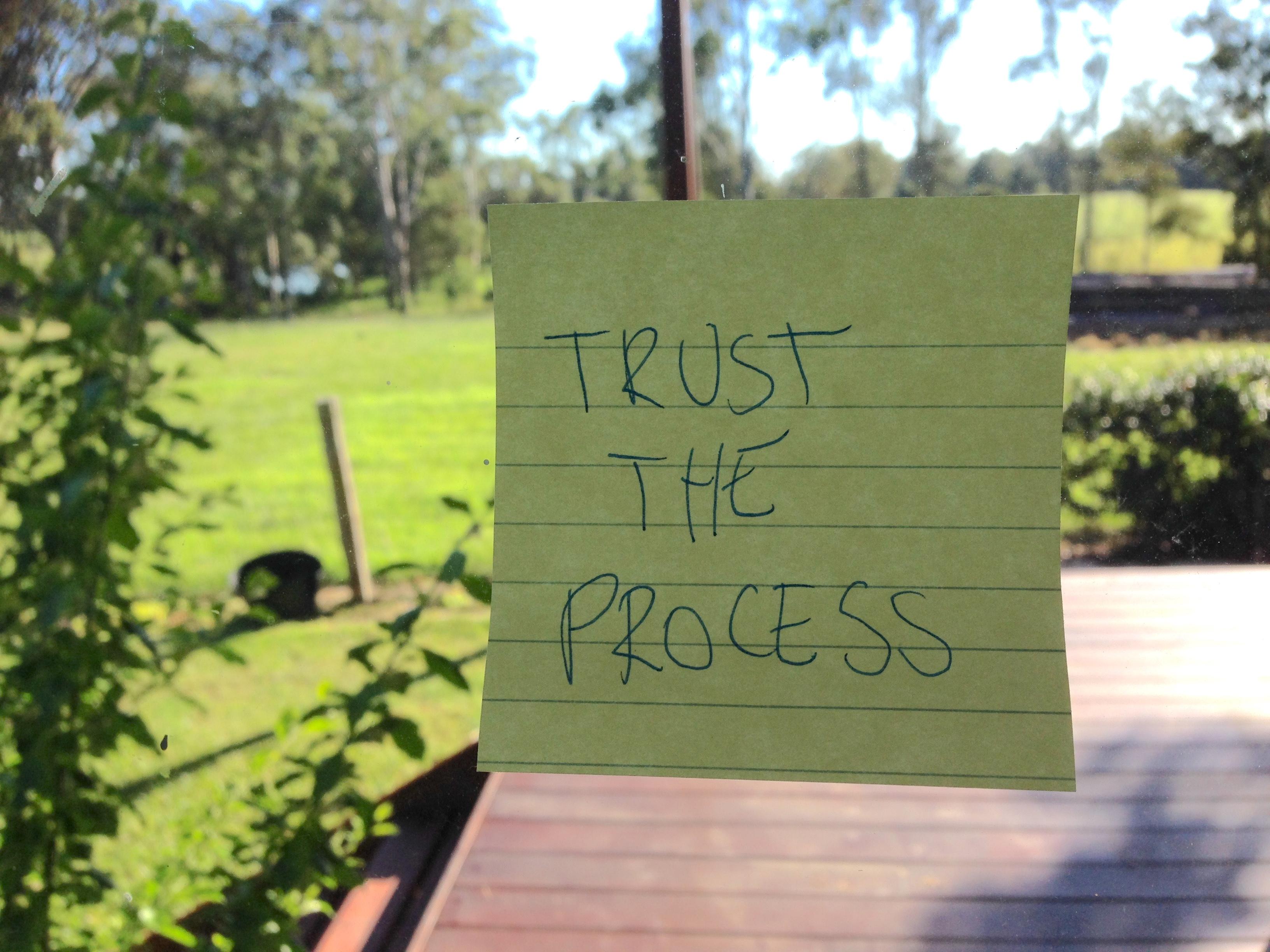 Trust the Process writing tip stuck on window