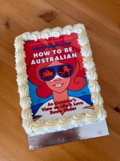 Cake with white icing, book cover of how to be Australian