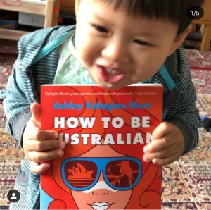 Toddler with How To Be Australian by Ashley Kalagian Blunt