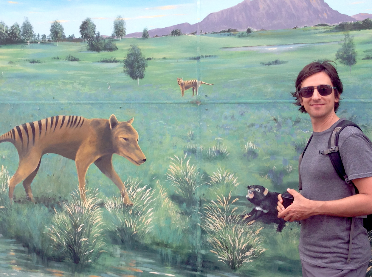 Man with Tasmanian tiger mural