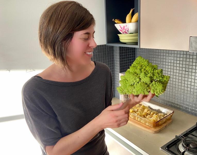 Woman holds Romanesco cauliflower
