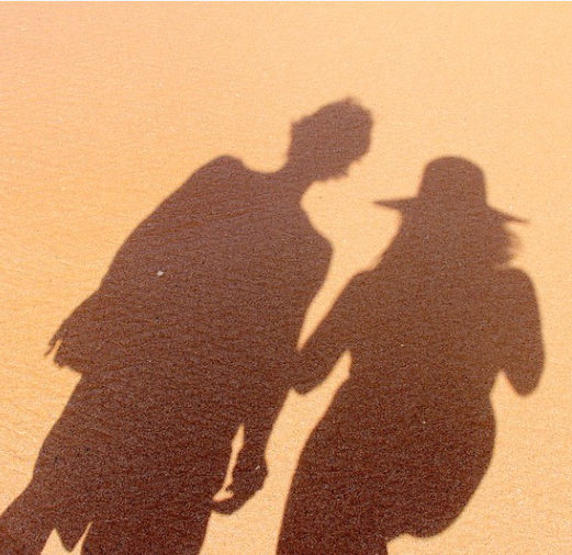 Couple shadowed on sand