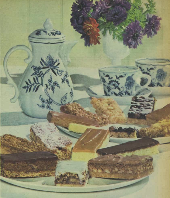 Variety of desserts on platter and jug, cups and saucers
