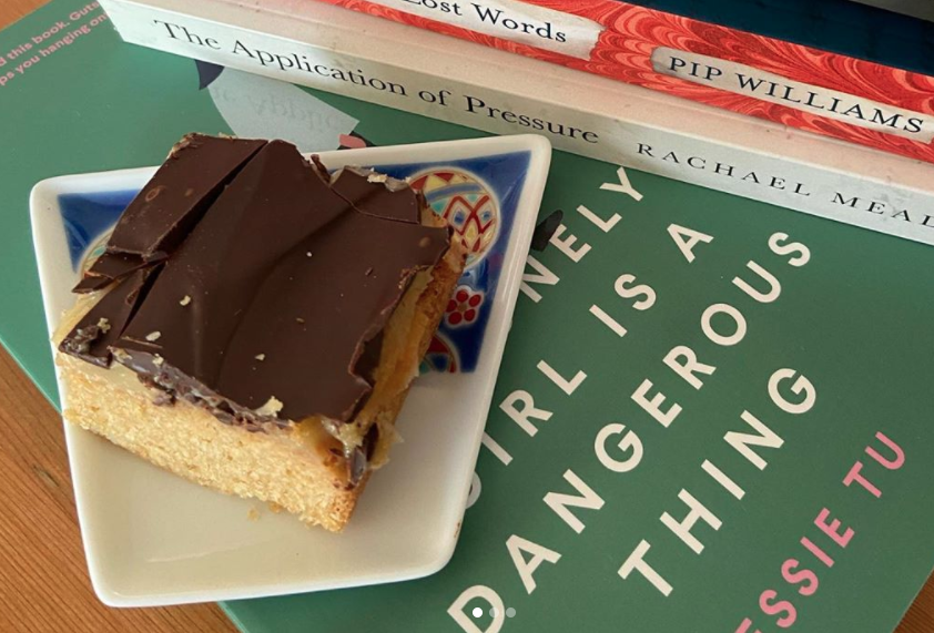 Homemade caramel slice on books